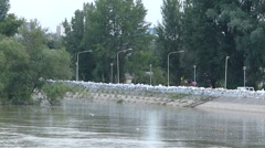 Sandbags wall on the river Stock Footage