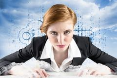 Composite image of redhead businesswoman sitting at desk typing - stock illustration