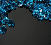 Many blue gems on black Stock Photos