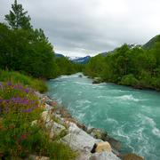 Stock Photo of fast river in scandinavian landscape