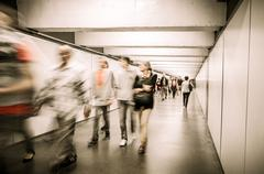 Moving crowd in underpass Stock Photos