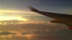 Sunset during a flight from china airlines Stock Footage