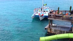 Water slide and sailboat at Margaritaville montego bay jamaica - stock footage