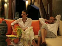 Stock Video Footage of Unhappy, offended couple sitting on sofa at home NTSC