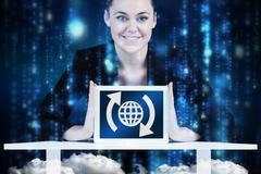 Composite image of businesswoman sitting at desk showing tablet - stock illustration