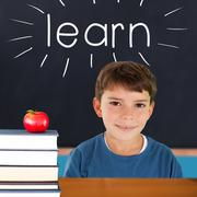Stock Illustration of Learn against red apple on pile of books in classroom