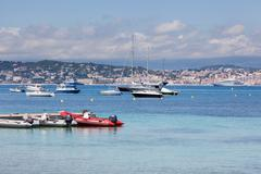 Stock Photo of Cannes: view from Lerins island. small and large yachts anchored in the bay.