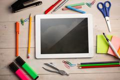 Composite image of digital tablet on students desk Stock Photos