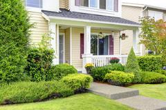 Classic american house exterior. entrance porch Stock Photos
