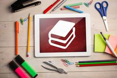 Stock Illustration of Composite image of digital tablet on students desk