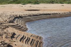 Parallel lines on embleton beach sandbank Stock Photos
