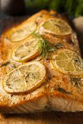 homemade grilled salmon on a cedar plank - stock photo