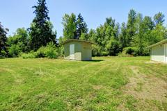 Countryside landscape. backyard with small shed Stock Photos