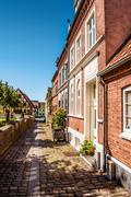 Old fashioned street architecture with apartments Stock Photos