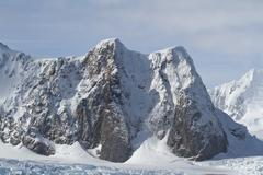 mountains of the antarctic peninsula summer day - stock photo