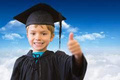 Composite image of cute pupil in graduation robe - stock photo