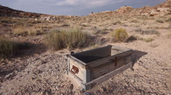 Abandoned Uranium Miners Chest in the American West Wide Shot Front Shot Stock Footage