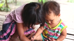Child playing at a small village in Chiang Mai, Thailand. Stock Footage
