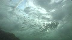 Waves crash on rocks underwater Stock Footage