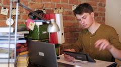 Happy student browsing internet on ipad at home - stock footage