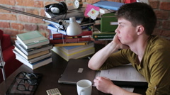 Distracted student cannot start working again at home Stock Footage