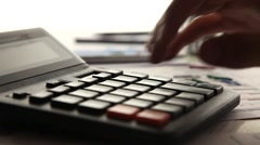 Business man working with calculator in the office - stock footage