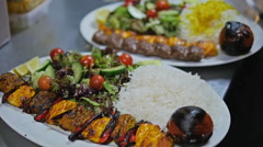 Rice dish being prepared to serve with Kebabs Stock Footage