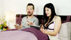 Man cheating with wife while playing game on tablet Stock Footage