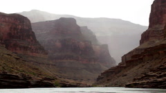 View of Grand Canyon From Colorado River During Rain - stock footage