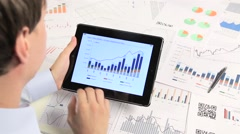 Business people developing a business project and analyzing market data. Stock Footage