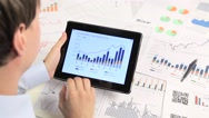 Stock Video Footage of Business people developing a business project and analyzing market data.