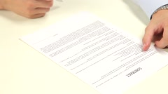 Man signing a contract Stock Footage