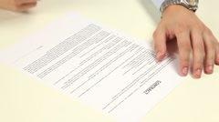 Man not signing a contract Stock Footage