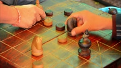 locals playing cambodian chess (ouk-khmer) - stock footage