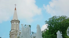 Tower of cathedral of the good shepherd and a fountain. singapore. Stock Footage