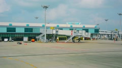 Parking place for passenger planes at the airport of singapore Stock Footage
