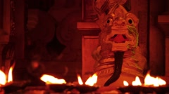 Lights in the ancient temple, dancing on the background of a stone monster. y Stock Footage