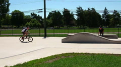 Young man performing a radical bmx jump at skatepark in slow motion Stock Footage