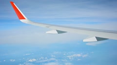 View from the window of the plane. seen wing and clouds Stock Footage
