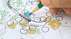 Landscape architect designing on site analysis plan Stock Footage