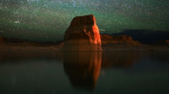 Astrophotography Time Lapse of Star Trails & Lone Rock over Lake -Rock Close Up- - stock footage