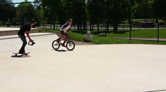 Young man performing a radical bmx jump at the skatepark takes a spill in slomo Stock Footage