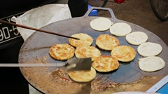 Cooking pancakes on the street for sale. burma, yangon Stock Footage