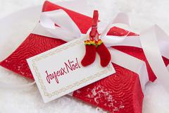 close up of red present box with french text for christmas - stock photo