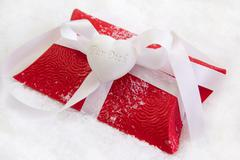 Close up of red present box with german text for christmas on white backgroun Stock Photos
