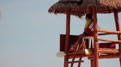 Life guard on watch tower tropical beach Stock Footage