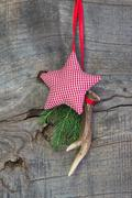 classic christmas decoration with antler and red white checked star on wooden - stock photo