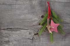 Top view of christmas decoration with antler and checked star on wooden backg Stock Photos