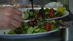Man putting dressing on a salad  - stock footage