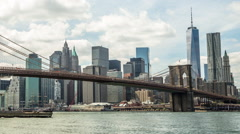 New York City Brooklyn Bridge downtown buildings skyline  time-lapse Stock Footage